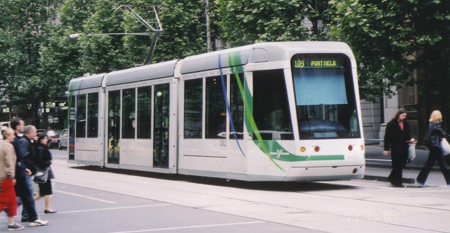 An LRT vehicle traveling throught the streets of Melbourne, Australia.
