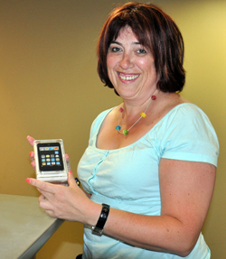 Contest Grand Prize winner Larisa Roiberg shows off her new iPod touch.